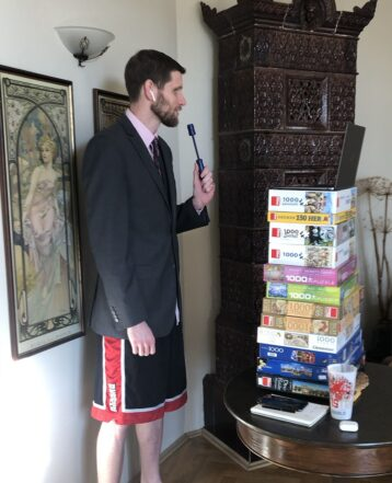 Man recording a live video with suit jacket and shorts
